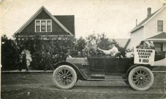 Car is a 1912 or 1913 Reo. J.F. driving, E Charles, Mrs Charles, my mother, my wife. Roleau Sports Day 1913