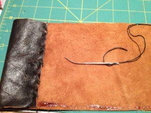 Make a pen pocket by folding the leather.