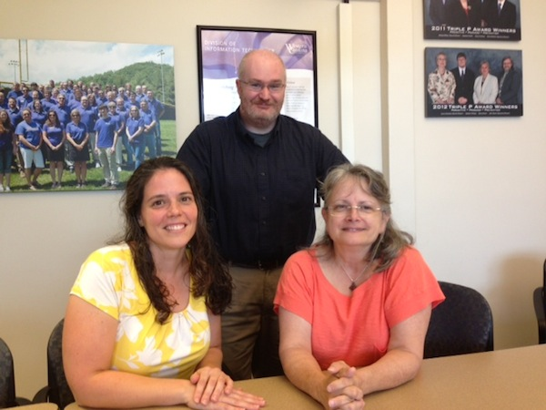 Sarah Speed, Neil Calvert, and Marjorie Eyre make up the IT Business Analysis Team.