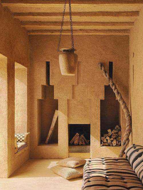1-7-wood-burning-fireplace-ideas-decoration-in-interior-design-concrete-finishing-in-oriental-style-wall-recesses-niches-for-storing-log-fire-bowl-lamp-pillows-beige-walls-ethnic-motifs1 | Дровяные камины: обзор материалов и лучших идей (Часть первая)