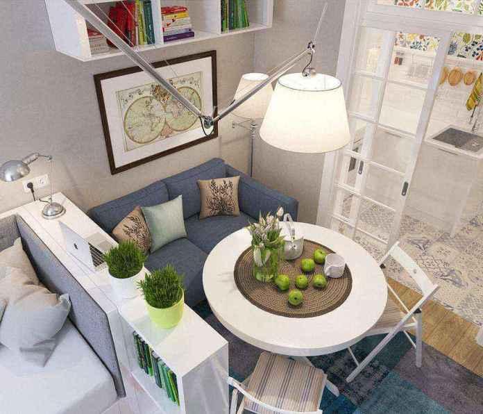 7-2-light-grayish-blue-studio-apartment-interior-design-in-modern-style-living-room-with-bed-sleeping-area-functional-zones-dining-area-round-table-folding-chairs-ikea-shelving-unit-pendant-lamp-arm | Как сделать удобной студию площадью всего лишь 25 квадратных метров? Узкая и маленькая студия