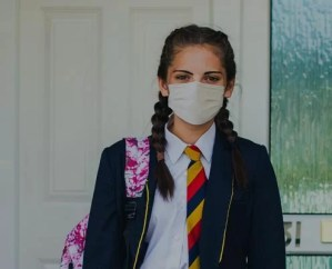 Student girl using mask to go to school where uses business processes automation solutions to reduce paperwork
