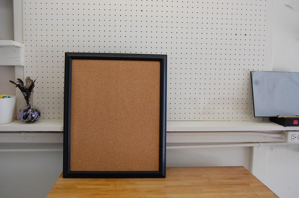T08 - Tada! A framed corkboard.