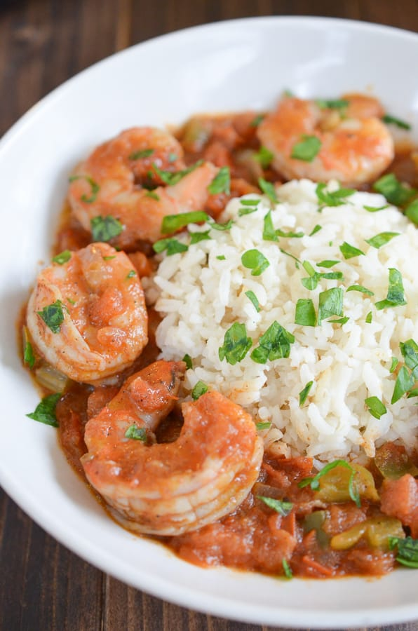 Easy Shrimp Creole Recipe- This easy shrimp creole recipe has jumbo shrimp, simmered in creole tomato sauce served over a steamy bed of rice. Can we say yummmm?