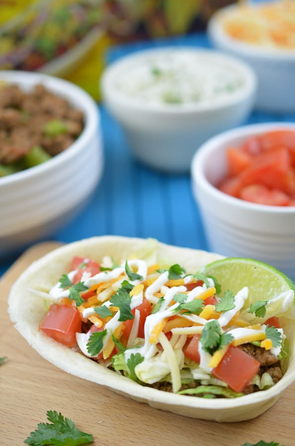Turkey Taco Boats-Spice up your next Cinco De Mayo with these delicious Turkey Taco Bowls. Flavorful, ground turkey combines perfectly with an edible Old El Paso Flour Tortilla Taco Boat.