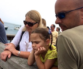 Watching dead fish fill a conveyer belt from a fishing boat on Cape Cod with Mimi