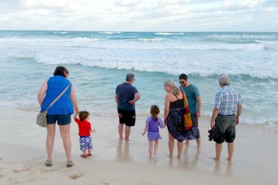 Family on the beach of the Caribbean Sea - Riviera Maya vacation