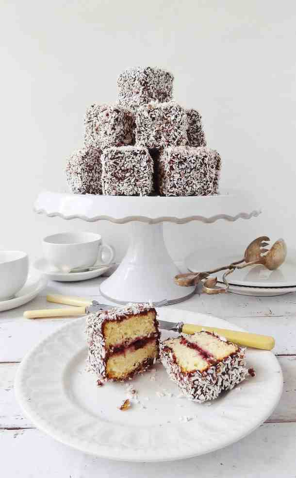 Cherry lamingtons - vanilla sponge filled with jam and coated in chocolate and coconut - Domestic Gothess