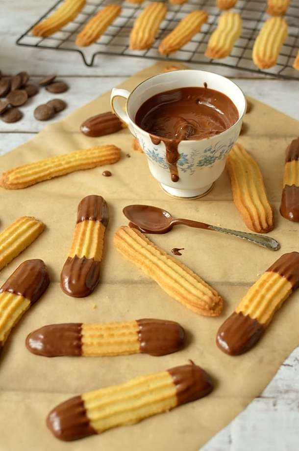 Milk chocolate dipped lime viennese finger biscuits