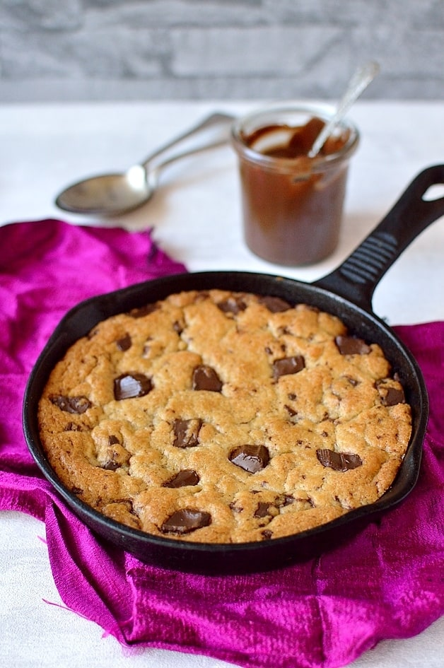 Mini nutella stuffed chocolate chunk skillet cookie for two (skookie) - crisp and chewy around the edges, and soft and gooey in the middle, this is the perfect indulgent dessert.