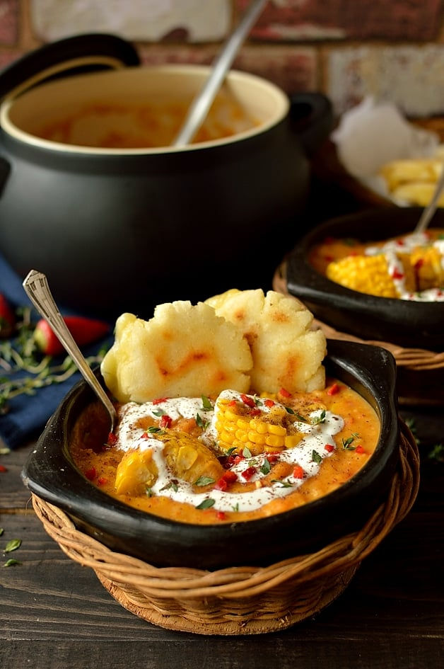 Creamy, spiced yellow split pea, sweetcorn and coconut soup with cheesy arepas (corn griddle cakes)