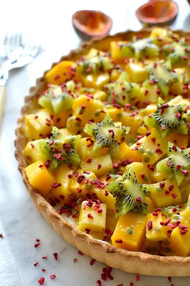 Tropical fruit coconut tart - crispy coconut pastry filled with coconut pastry cream, mango, pineapple, kiwi & passion fruit