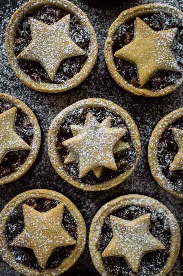Close up shot of lighter mince pies dusted with icing sugar