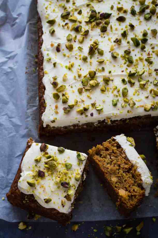Carrot, pineapple and pistachio traybake topped with cream cheese icing and chopped pistachios.