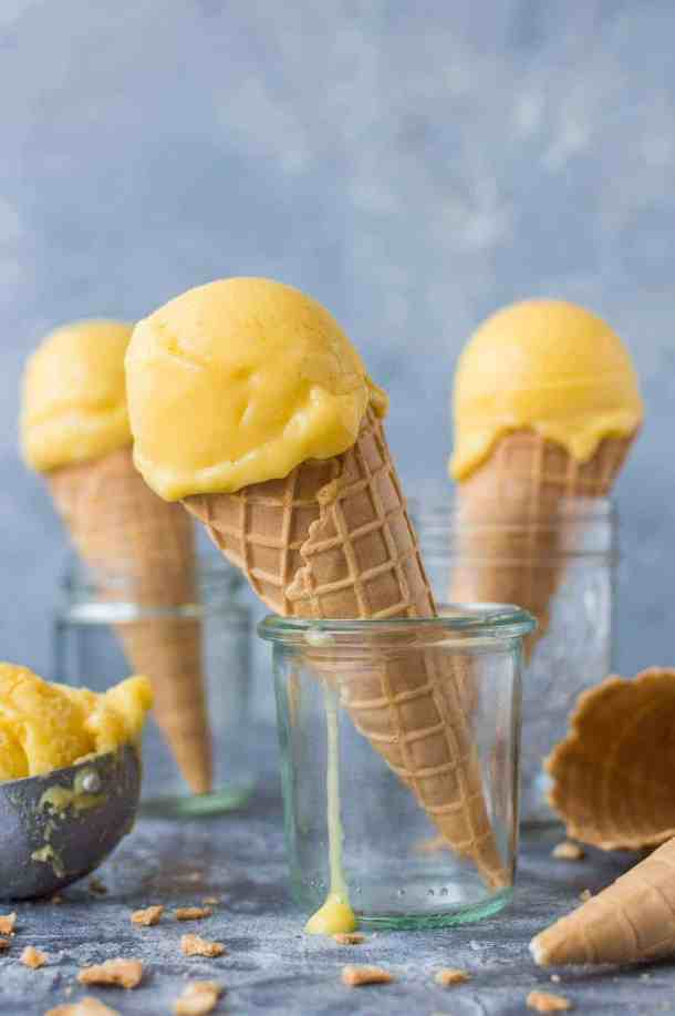 Mango lassi sorbet - a smooth, tangy vegan sorbet made with fresh mangoes, coconut yogurt and lime. The perfect refresher for hot weather! #vegan #icecream #sorbet #mango #yogurt