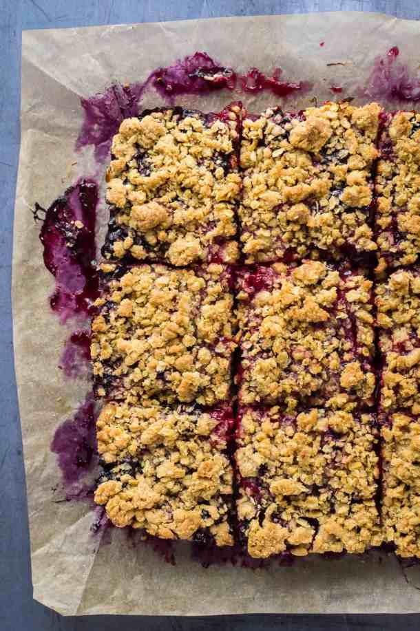 Photo of vegan berry crumble bars cut into squares