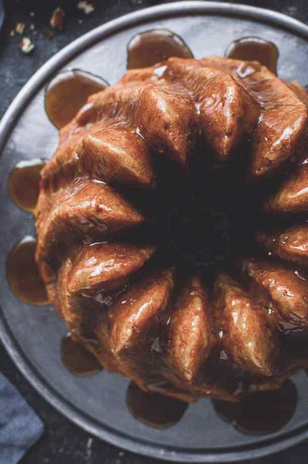 Close up top down shot of vegan apple bundt cake topped with coconut caramel.
