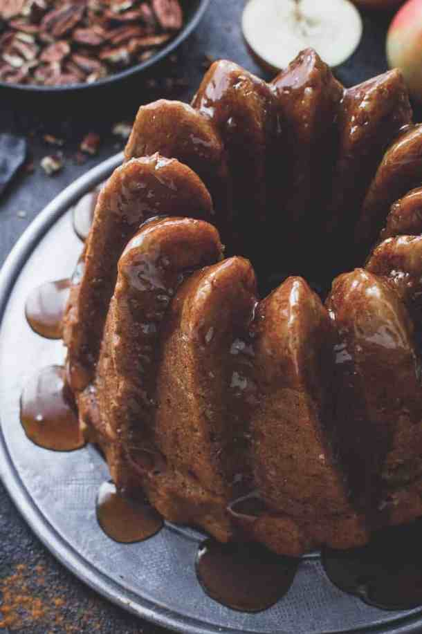 Vegan apple bundt cake - easy to make, moist and lightly spiced, this vegan apple cake is sure to be a hit. Made with both fresh apples and applesauce for the best apple flavour. #vegan #bundtcake #applecake #baking