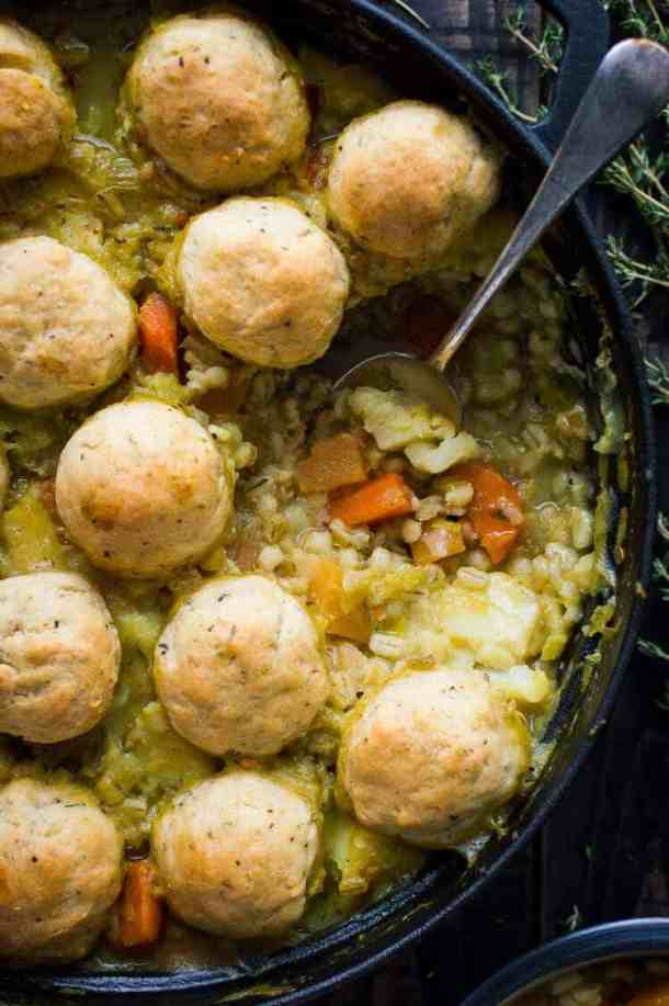 Winter vegetable and pearl barley stew with herby dumplings – a hearty, healthy and filling vegan vegetable stew topped with fluffy, herby dumplings. The perfect meal to warm you up on chilly days. #vegan #healthy #stew