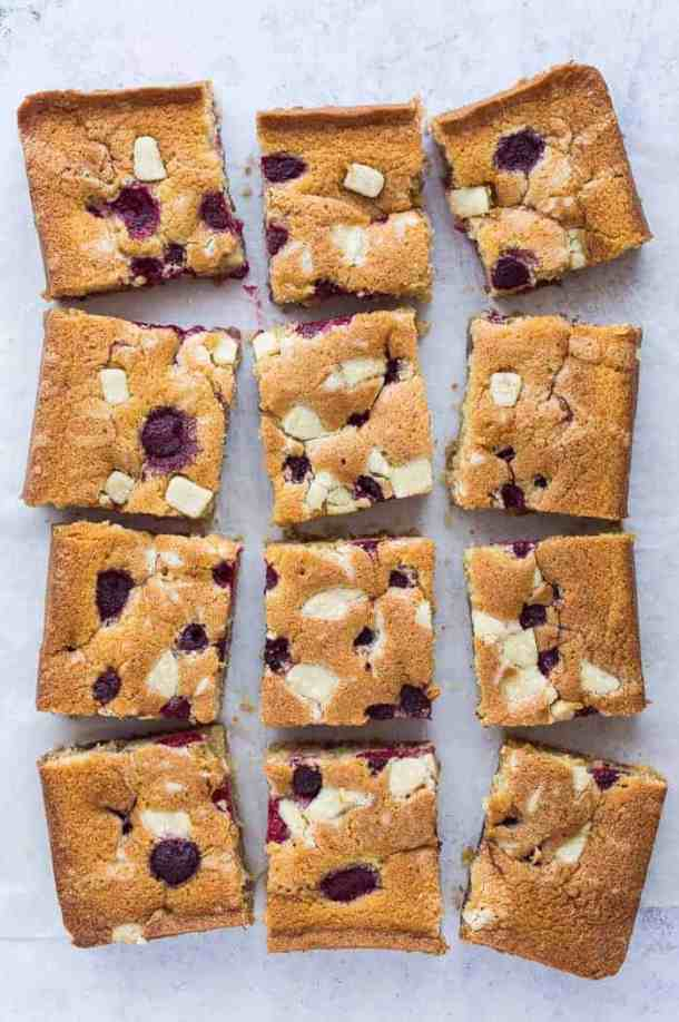Raspberry, white chocolate and almond sheet cake - this amazing eggless, dairy free and vegan traybake cake is wonderfully soft and moist and full of fresh raspberries and white chocolate chunks. #vegan #vegancake #veganbaking