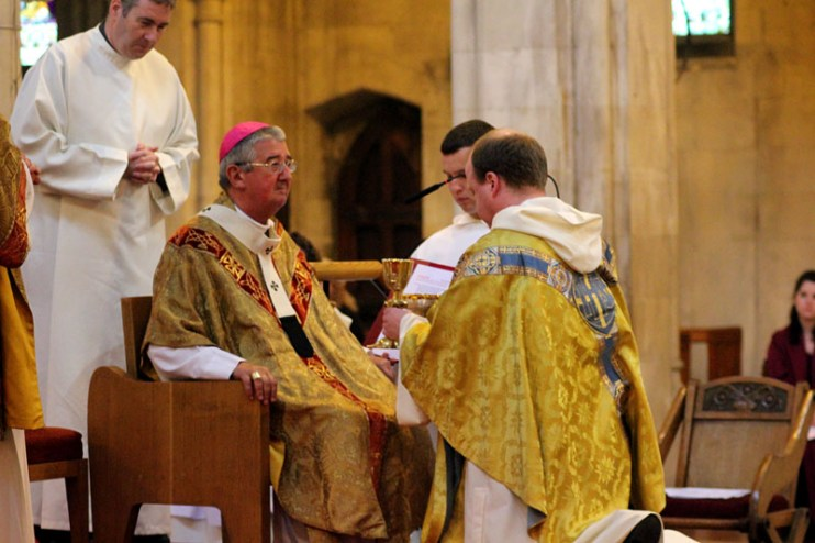 Fr. Maurice receives the chalice