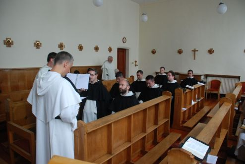 The brothers kneeling in the Choir