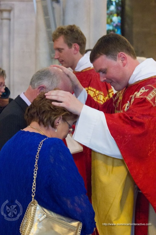Fr. Colm gives his first blessing to his parents