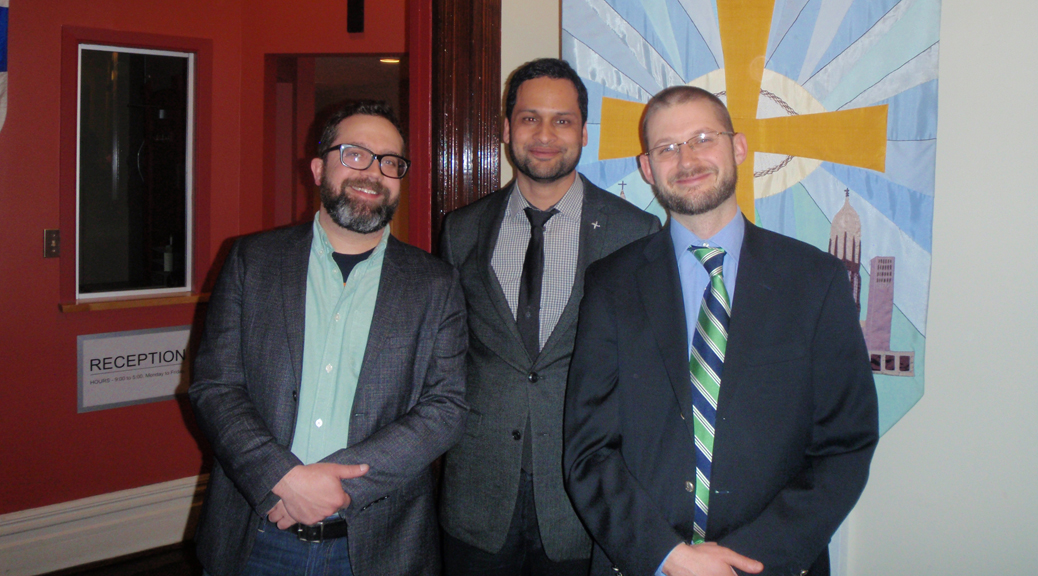 This picture shows the three key people behind the Dominican Institute of Toronto. Matthew Eaton (left), Darren Dias (centre) and Nick Olkovich (right) are all smiling and wearing suits.