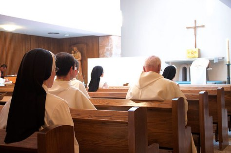 Members of religious orders are shown in a chapel during Lauds.