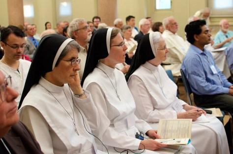 Sisters at the Promise of Renewal conference listen to a speaker.