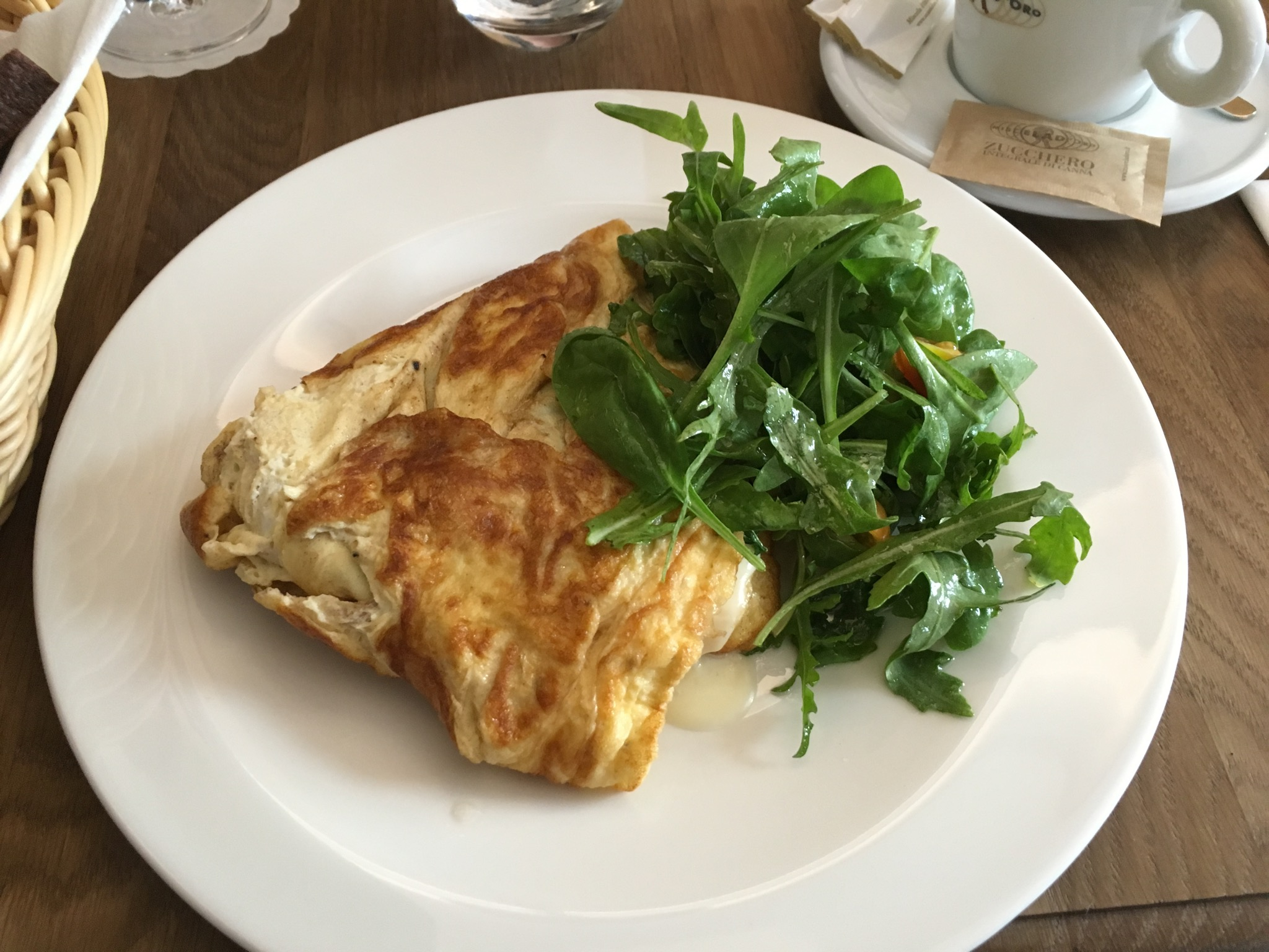 Omlette with cheese brie and small salad