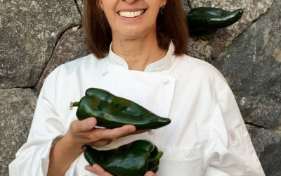 Magda Pablos picks and preps a peck of poblano peppers.