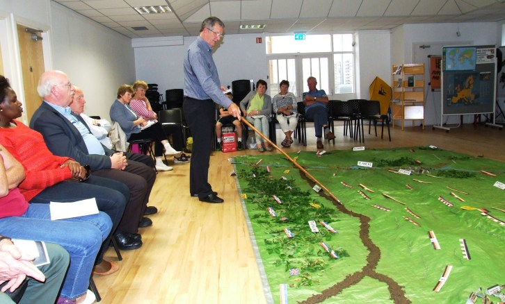 Retired Colonel Declan O'Carroll discusses the first day of the Battle of the Somme using a landscape model at the Central Library, Letterkenny on Thursday, August 25.