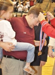 Biggersville Head Coach Eric Little and his daughter Lainey receive their medals following the Lions 2013 State Championship win.