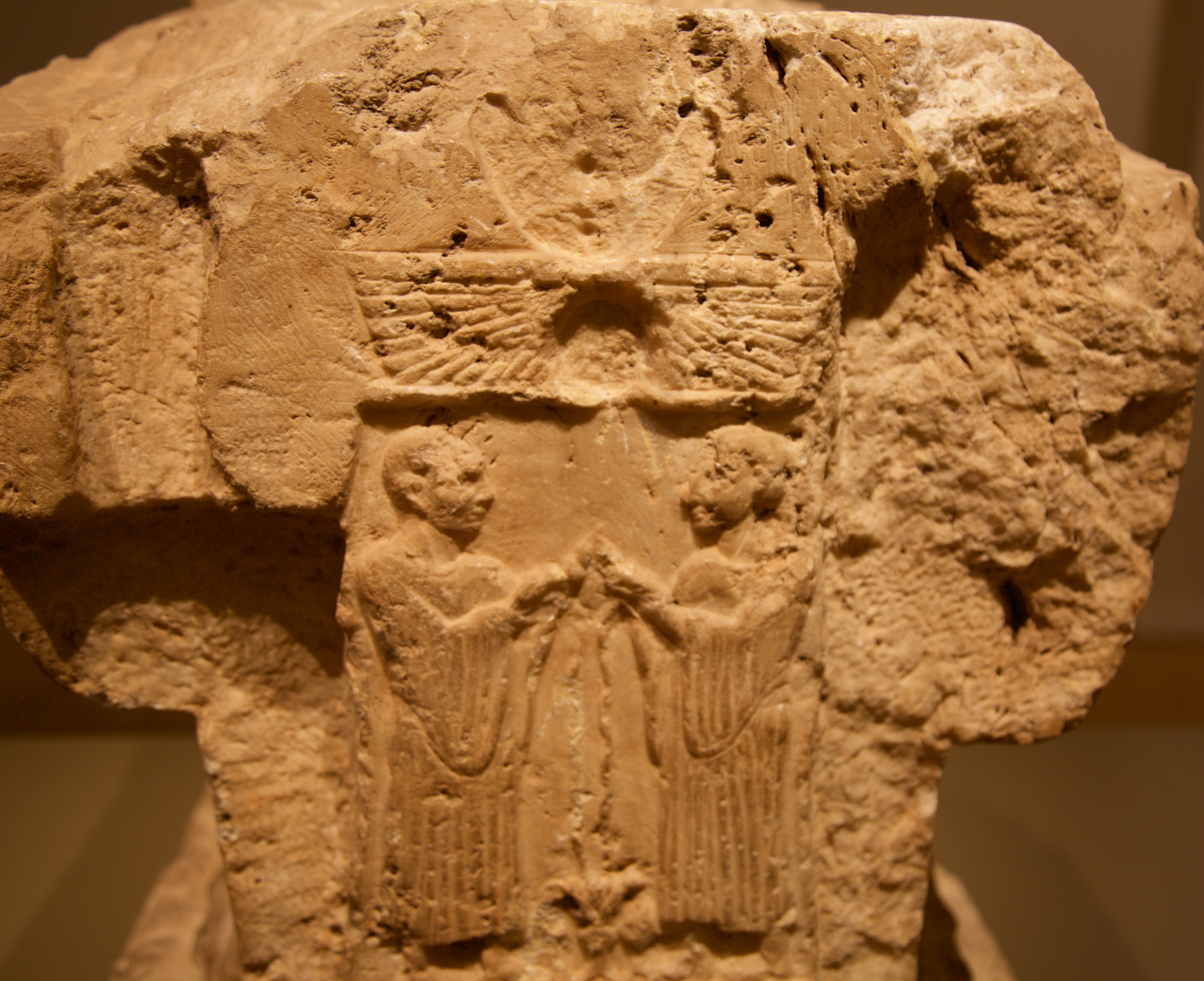 """Palm tree, tree of life, representing the fertility provided by Astarte. Situated between the two winged sphinx guarding her """"empty"""" throne. The winged disc hovers over the couple. Hellenistic period. Don Michael Hudson, PhD National Museum of Beirut Beirut, Lebanon"""