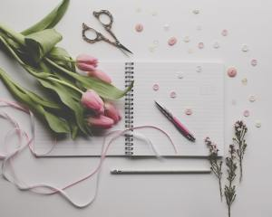 flowers and journal on a desktop
