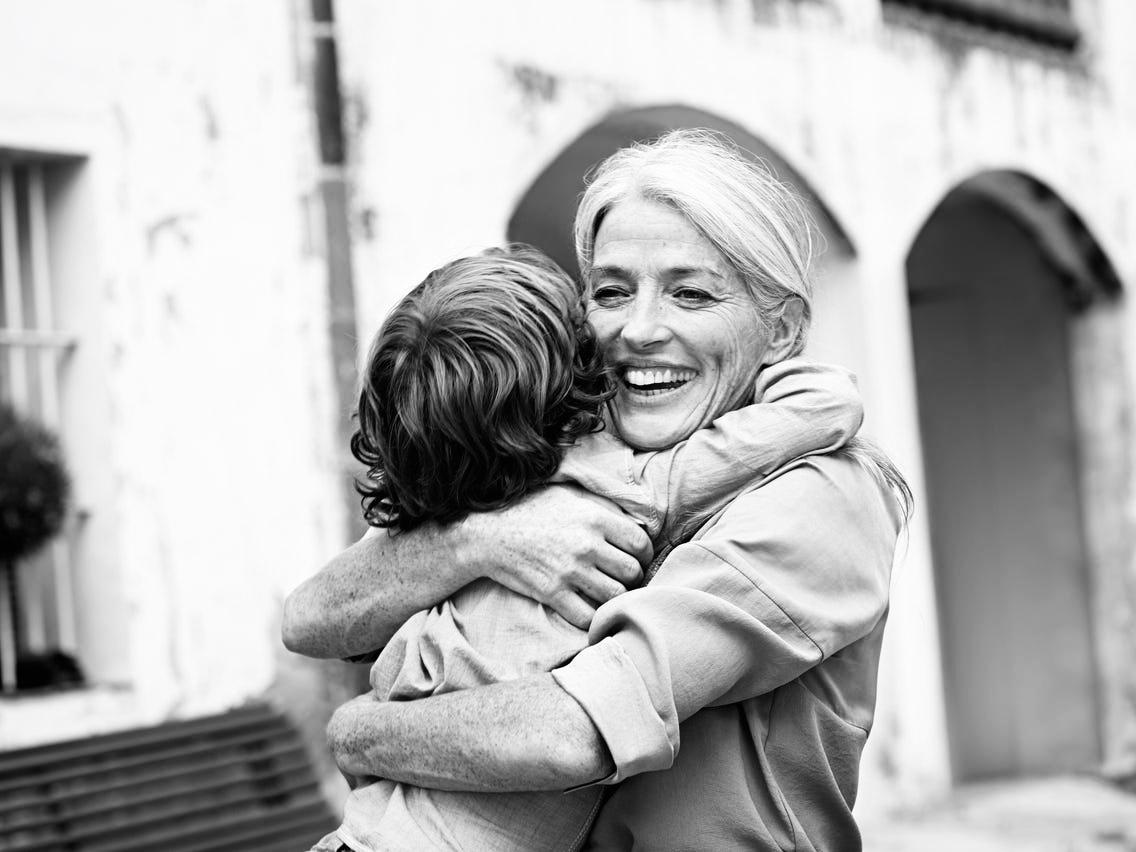 Italian granndparents hug grandchildren