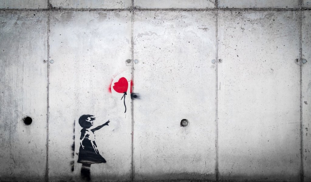 Little girl releasing balloon