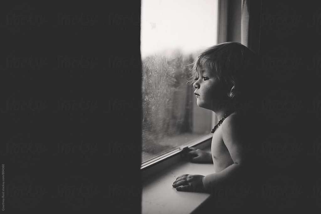 Toddler boy at window
