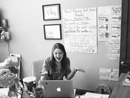 A school teacher talking to her class on computer