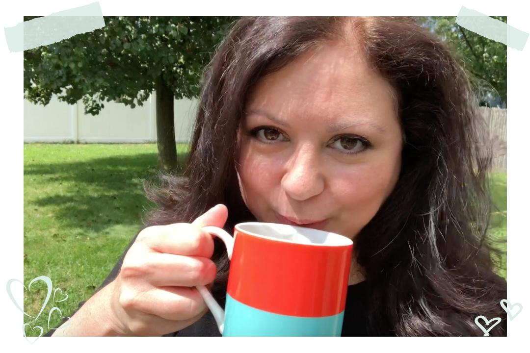 Donna DeRosa drinking coffee