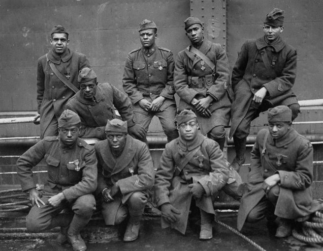 Harlem Hellfighters who won the Croiz de Guerre for gallentry in action. Left to right. Front row: Pvt. Ed Williams, Herbert Taylor, Pvt. Leon Fraitor, Pvt. Ralph Hawkins. Back Row: Sgt. H. D. Prinas, Sgt. Dan Strorms, Pvt. Joe Williams, Pvt. Alfred Hanley, and Cpl. T. W. Taylor.