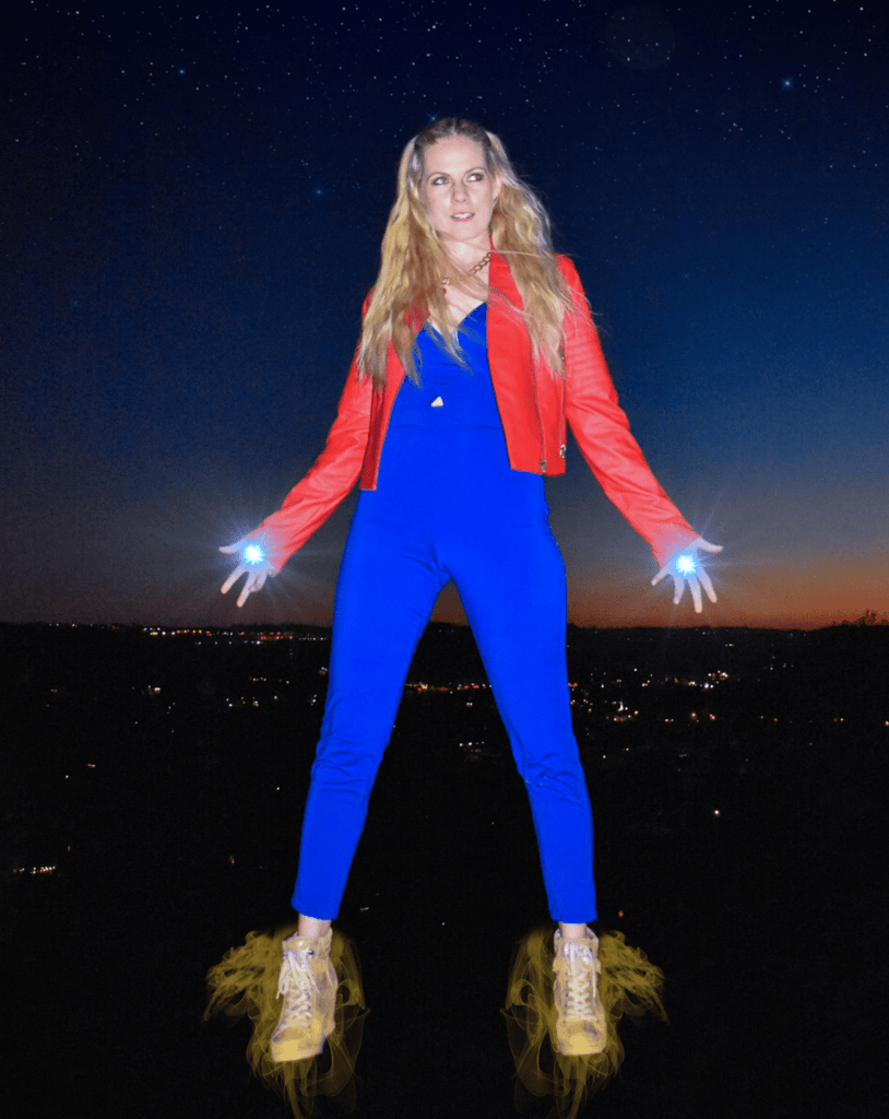 A simple Captain Marvel Disney Bound is possible with just a red jacket, a blue jumpsuit, and some gold accents to your outfit. I decided to add a few superhero effects to my picture on my hands and feet to make it look like I am flying through space.