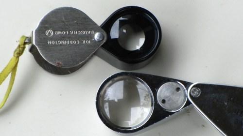 A basic Coddington hand lens on the left. A lighted hand lens on the right.