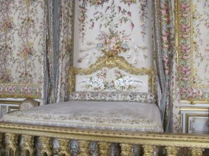 The Queen's bedchamber at Versailles. The Queen gave birth, in public, to heirs in this room. Photo by Donna L. Long, 2014. All rights reserved.
