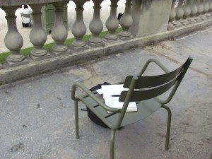 My journal rests on my seat in Paris' Luxembourg Gardens