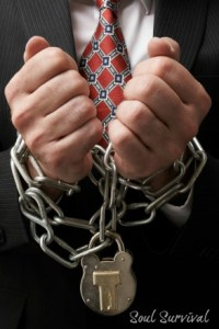 kozzi-Businessman_in_chains-294x441