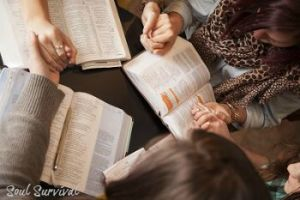 prayer with bibles holding hands