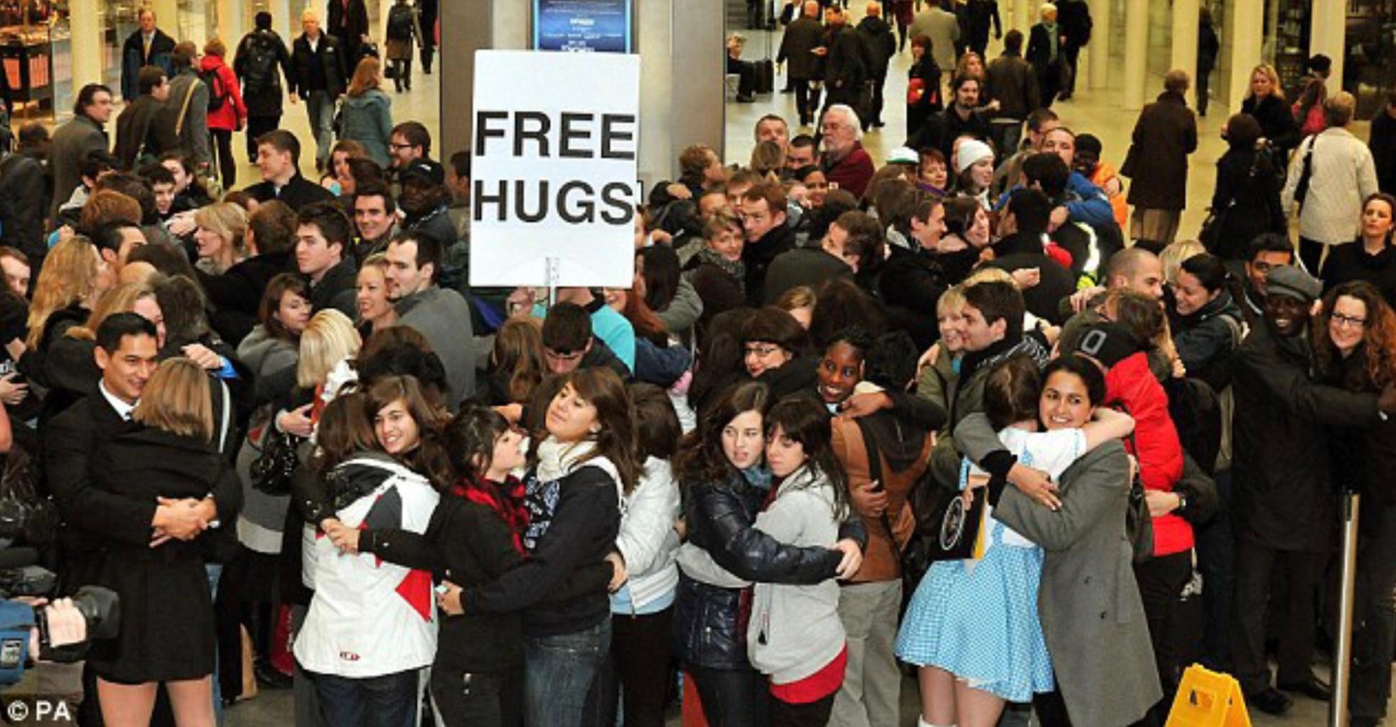 people hugging each other free hugs