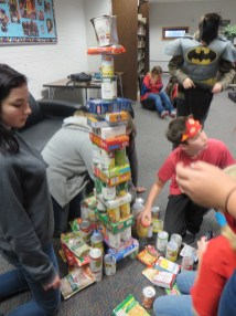 Creating the Eiffel Tower out of canned/boxed food.